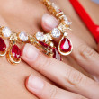 Hand touching necklace - Stock Photo