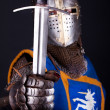 Knight holding a sword — Stock Photo