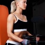 Blond Athlete holding dumbbells — Stock Photo