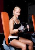 Smiling blonde doing exercise — Stock Photo