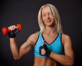 Athlete with dumbbell — Stock Photo