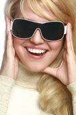 Young fashionable girl in sunglasses — Stock Photo