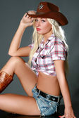 Beautiful sexy rodeo cowgirl — Stock Photo