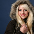 Сharming blonde in a fur hood — Stock Photo #3239710