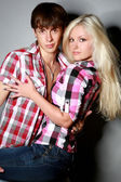 Glamour pair on a grey background — Stock Photo