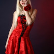 Beautiful blonde in a red satiny dress — Stock Photo #3875435