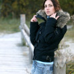 Beautiful girl near the wooden bridge — Stock Photo #3909110