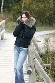 Beautiful girl near the wooden bridge — Stock Photo
