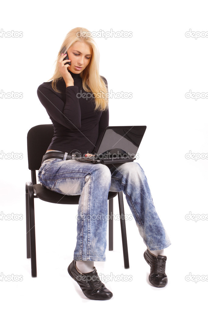 Pretty funny blonde with a laptop and a phone number on a white background. Studio shooting  Stock Photo #3740941