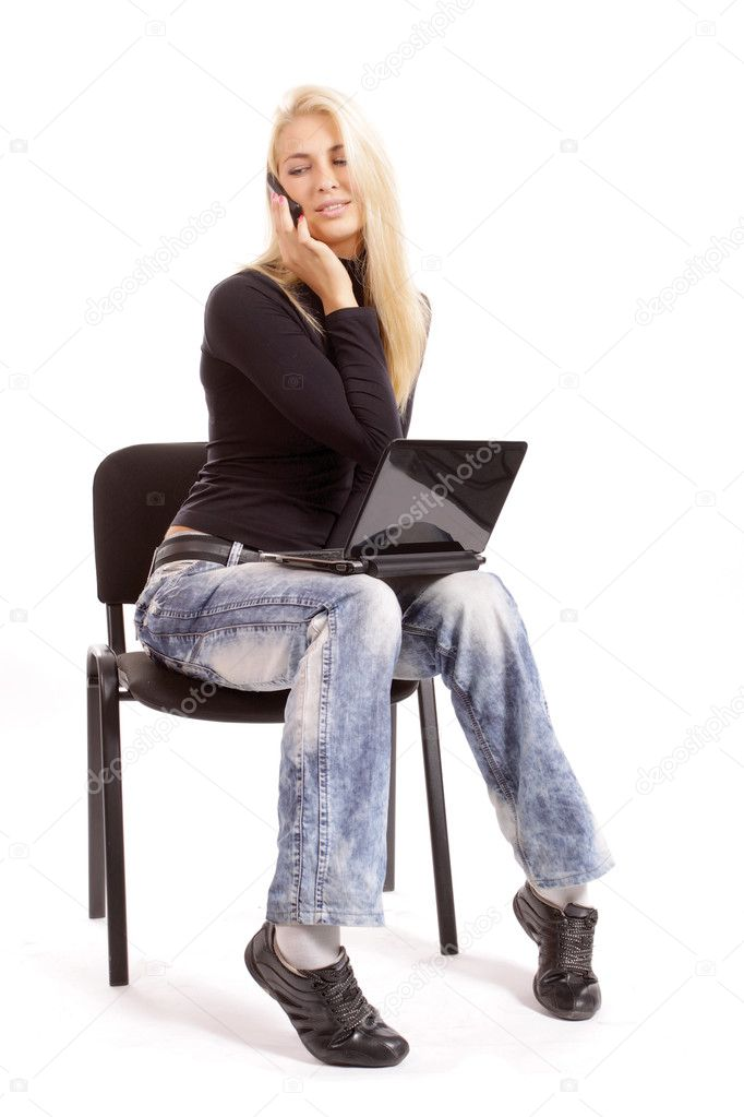 Pretty funny blonde with a laptop and a phone number on a white background. Studio shooting — Stock Photo #3740950