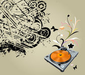 Turntable and flowers — Stock Photo