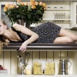 Woman on the table — Stockfoto