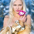 Blonde with orchid — Stock Photo