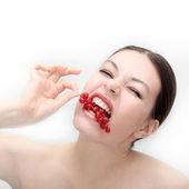Girl eats a currant — Stock Photo