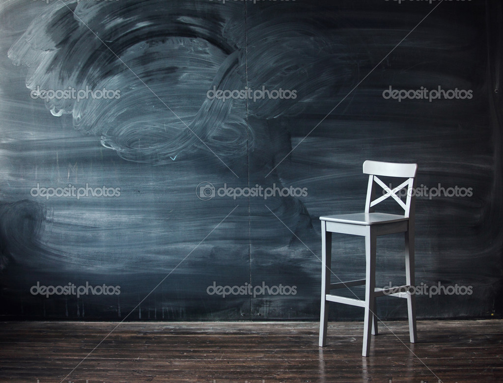 Wooden chair against a school desk for the letter. Impressive background  Stockfoto #2883150