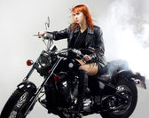 Red-haired girl on a motorbike — Stock Photo