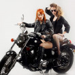 Royalty-Free Stock Photo: Two girlfriend on a motorbike