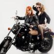Two girlfriend on a motorbike — Stock Photo