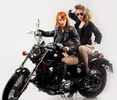 Two girlfriend on a motorbike — ストック写真