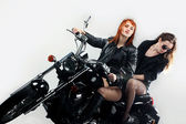 Girls on a motorbike — Stock Photo