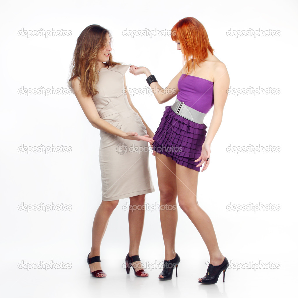 Two girlfriends discuss clothes. Girlfriends are dissatisfied with clothes each other — Stock Photo #2930306