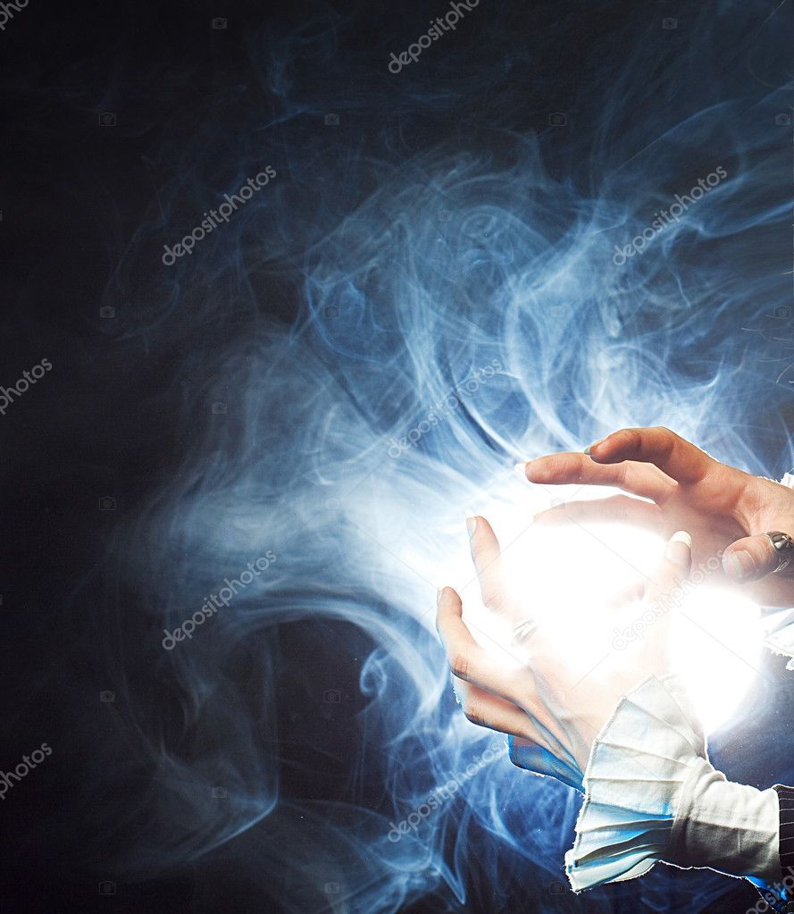Magic blow. The sorcerer generates magic force in the hands  Stockfoto #3100096