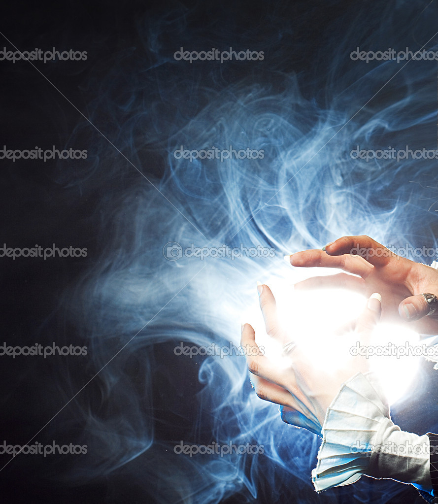 Magic blow. The sorcerer generates magic force in the hands — Stok fotoğraf #3100096