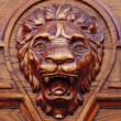 Big wooden head of lion — Stock Photo