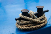 Old mooring bollard with heavy ropes — Stock Photo