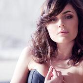 Beautiful elegant brunette in a corset. — Stock Photo