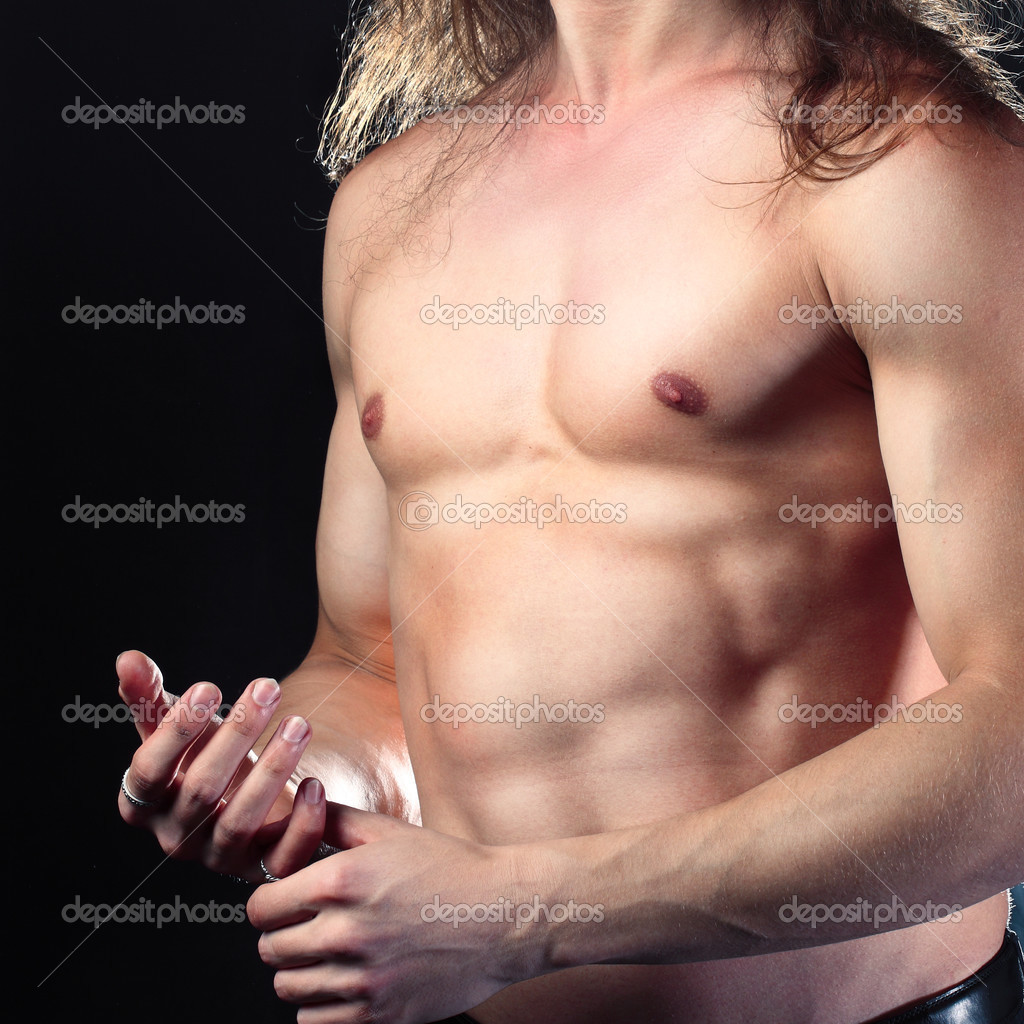 Young sporty man. Muscles, a close up — Stock Photo #3353663