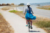 Beautiful girl riding bicycle — Stock Photo
