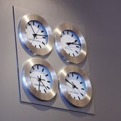 Clocks on a wall — Stockfoto