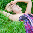 Girl on a meadow - Stock Photo