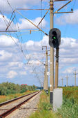 Railroad and semaphore with green signal — Стоковое фото