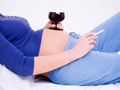 Pregnant woman with a glass of wine — Stock Photo