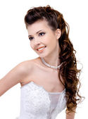 Smiling bride curly wedding hairstyle — Stock Photo