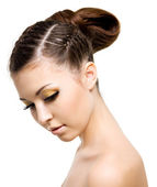 Woman with style hairstyle of pigtail — Stock Photo