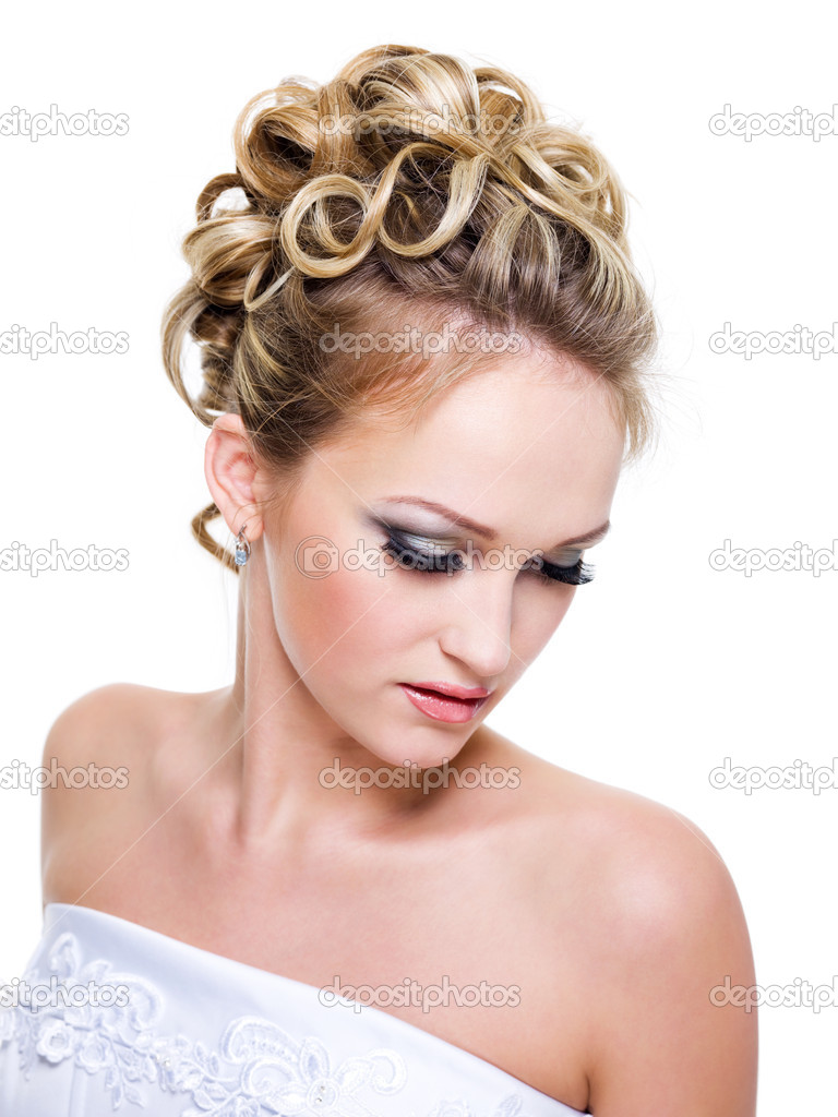 Beautiful bride with fashion wedding hairstyle -  on white background — Stock Photo #2986937