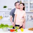 Romantic couple in the kitchen — Stock Photo