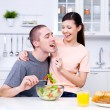 Happy flirting couple in the kitchen - Stok fotoraf