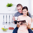 Stock Photo: Happy loving couple in the kitchen
