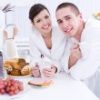 Smiling lovers in the kitchen — Stock Photo