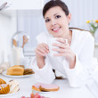 Beautiful woman having breakfast — Stock Photo