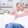 Smiling woman relaxing at home — Stock Photo
