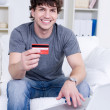 Stock Photo: Handsome man with credit card