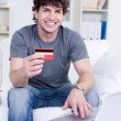 Handsome man with credit card — Stock Photo