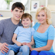 Happy family with son at home — Stock Photo