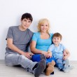 Family sitting together on the floor — Stock Photo