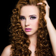 Foto de Stock  : Beautiful womwith long curly hairs